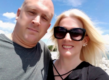 The author, Kari, with her husband at the beach
