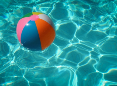A beach ball floating in a pool