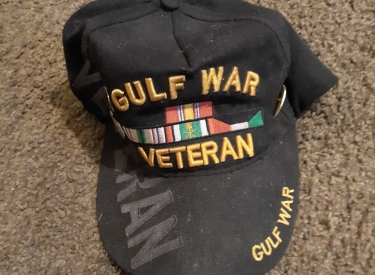 "The author's baseball hat, which reads ""Gulf War Veteran"""