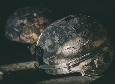Photo by Israel Palacio. Image of camo-printed army helmets.