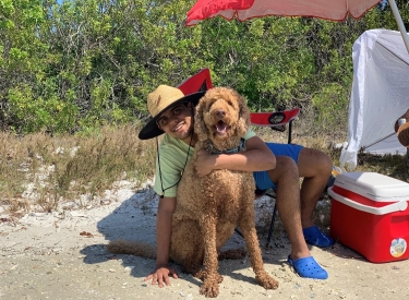 The author on the beach with his dog
