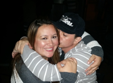 Jaclyn Brown hugs her brother while he kisses her on the cheek