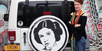 The author in front of her car, which features a Princess Leia tire cover