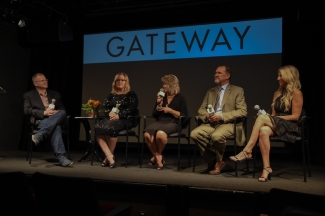 Three women and two men sit in directors' chairs on stage at the premiere of Gateway